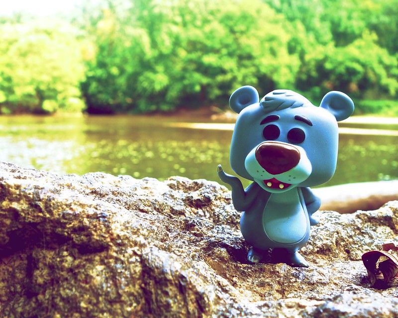 Funko Pop! Disney #55 Baloo Vinyl Figure sitting by a river